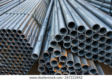 Metal pipes are stored in a warehouse hexagonal cells