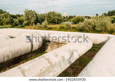 Metal pipes in the field. gas pipeline for pumping gas. heat pipe. big pipe for hot water pipeline #1402850930