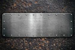 Metal plate on rusty steel background