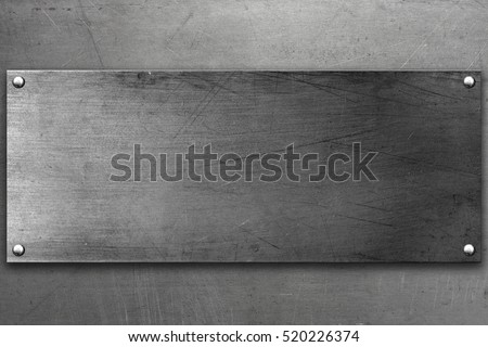 Metal plate with rivets on steel background #520226374