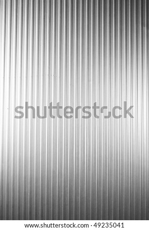 Metal plate with vertical lines