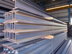 Metal profile Beam in packs at the warehouse of metal products.