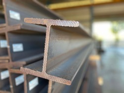 Metal profile beam steel  in packs at the warehouse of metal products, thailand