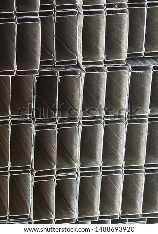 Metal profiles stored at the construction site. Closeup. Selective focus