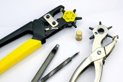 Metal punchers with replaceable attachments. Device for making holes in leather and fabric. Special hand tools are used in the sewing industry.