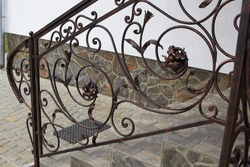 Metal railing forged,stairs to the house with metal railings with forged parts