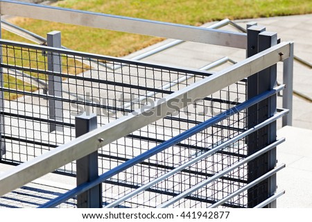 metal railings for balconies and stairs, note shallow depth of field