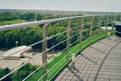 Metal railings. Grass.