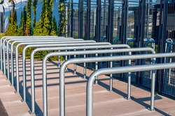 Metal railings in front of gates of Silesian Stadium in Chorzów, Poland. Row of steel rails. Entrance to the sport arena.