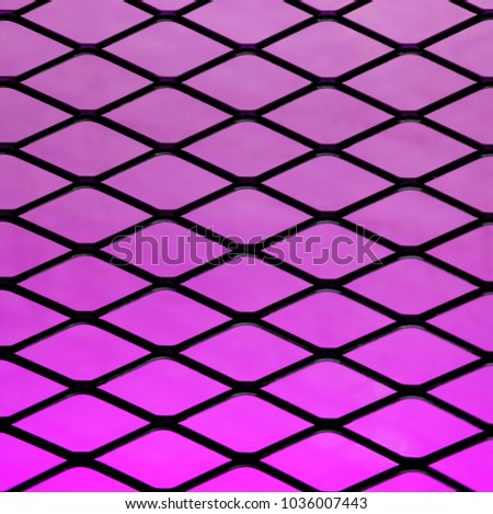 Metal rhombus mesh and violet gradient light background. #1036007443