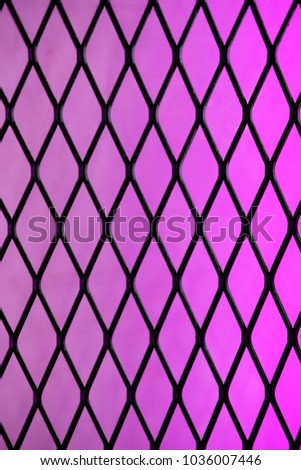 Metal rhombus mesh and violet gradient light background. #1036007446
