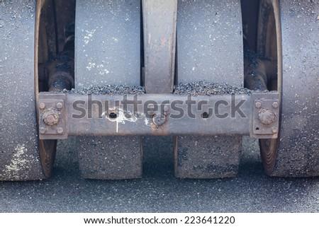 Metal roller compactor at asphalt pavement works for road repairing