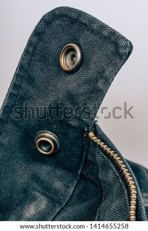Metal round studs on a black jacket. Decorative elements on clothes. Stock photo ©