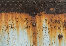 Metal rust texture with riveting, abstract grunge background