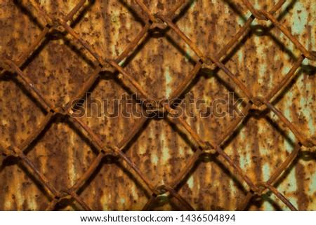 metal rusty lattice on rusty metal background. #1436504894