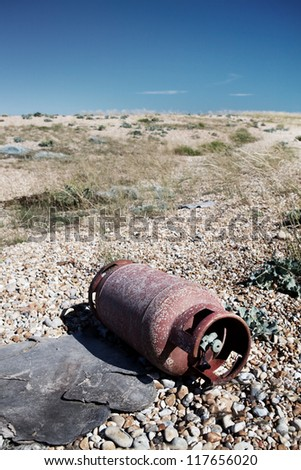 metal scrap abandoned on the beach. discarded iron pollution and enviromental hazard