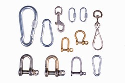 Metal shackles and slings used on a sailboat. Accessories for joining ropes in sailing. Isolated background.