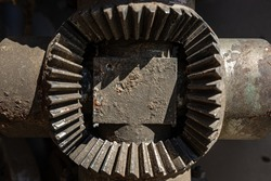 Metal sheet, garage part, bolted, carving wheel disc, nuts, screws, traces of rust and old paint and metal corrosion, cracks