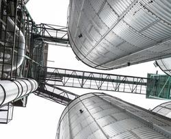 Metal silo for grain storage on the farm, bottom view