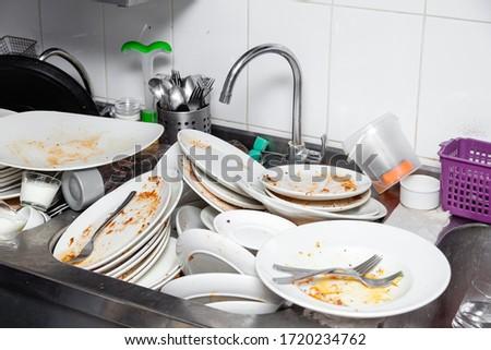 Metal sink full of dirty dishes, crockery, tableware Photo stock ©