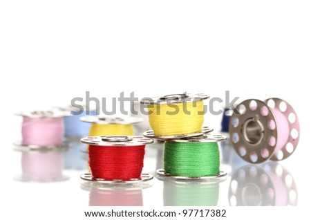 Metal spools of thread isolated on white