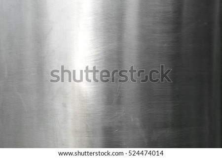 Metal stainless steel surface background or aluminum brushed silver metal texture with reflection.