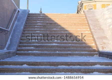 metal stair railing and stairs with snow