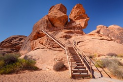 Metal staircase leading to Atlatl Rock with 4000 years old Petroglyphs from Native Americans, in Valley of Fire State Park, Nevada, USA