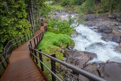 metal stairs and mountain stream and waterfall