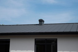 Metal standing seam roof and chimney