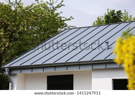 Metal standing seam roof on a residential home Сток-фото ©