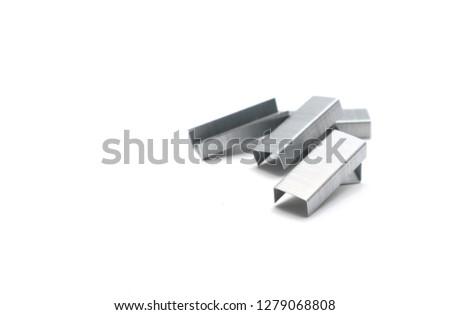 Metal staples for stapler on white background
