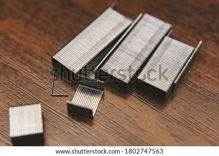 metal staples on wooden background Photo stock ©