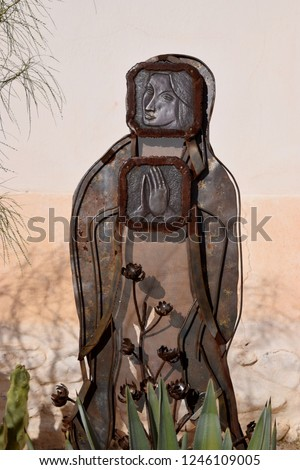 Metal statuary of Virgin Mary, Mission San Xavier del Bac is a historic Spanish Catholic in Tucson, Arizona, on the Tohono O'odham Nation San Xavier Indian Reservation.