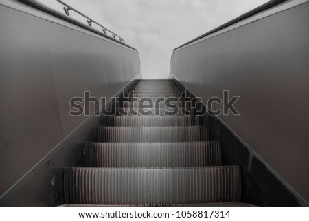 metal steps or stairs on an escalator #1058817314
