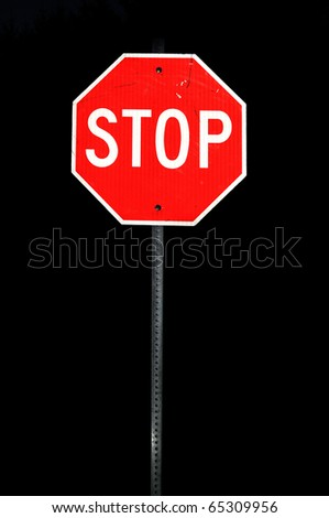 Metal stop sign during the night time