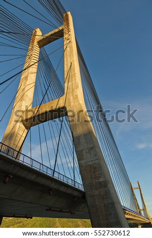 Metal straps or cables in the concrete tower cable-stayed bridge with a fan design  #552730612