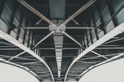 Metal structures under the bridge, large metal bridge over water