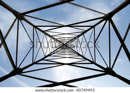 Metal support of an electric transmission line on sky background