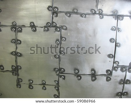 Metal surface with rivets. Background