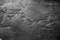 Metal surface with scratches and dents.