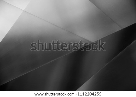 Metal surfaces / facets. Abstract architecture close-up photo with elements of modern building. Constructive background in minimal style. Polygonal geometric composition.