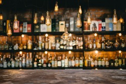 Metal table and vintage lamps  with liquor bar background