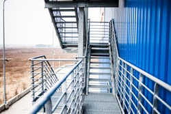 Metal technical steps on the building