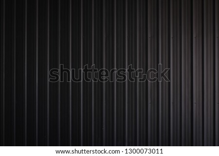 metal texture pattern, ribbed cast iron surface, textured black background , wall for dark backdrop , loft style interior. Foto stock ©