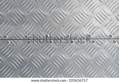 metal texture, shiny aluminum background with diagonal relief part