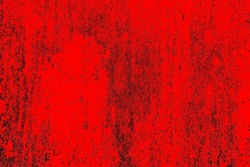 Metal texture with scratches and cracks. Image includes a effect the black and red tones. Black and red metal background.