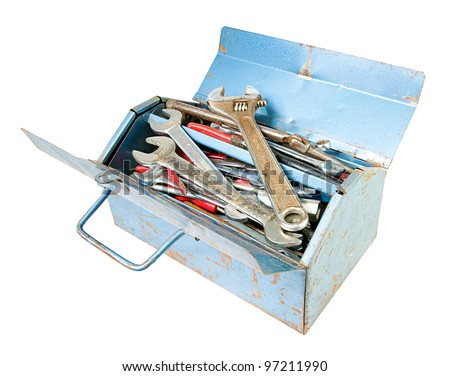 metal toolbox full of tools including spanners isolated on white
