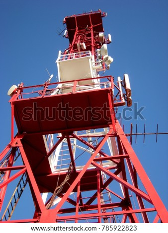 Metal tower - repeater of the television air signal and signal of the cellular network #785922823