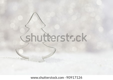 metal tree cookie cutter with beautiful background
